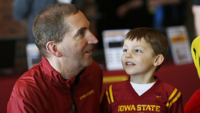Director of Athletics Jamie Pollard greets young fan Nicholas Carslon, 5, and his family Tuesday, May 12, 2015, during the first stop of the 2015 Cyclone Tailgate Tour at the Bridgeview Center in Ottumwa, Iowa. The tour is scheduled to make 9 stops across Iowa.