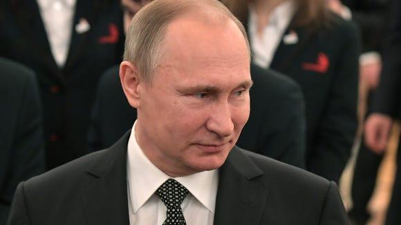 Russian President Vladimir Putin meets with members