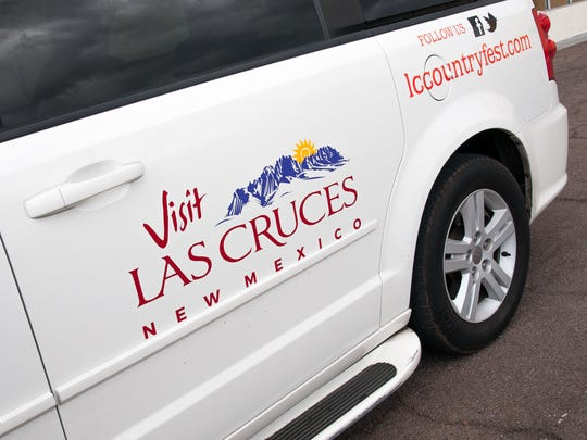 "A Las Cruces city van bears the ""Visit Las Cruces"" brand adopted by the city's convention and visitors bureau in 2015."