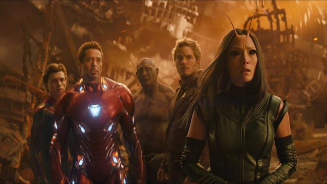 """Tom Holland, from left, Robert Downey Jr., Dave Bautista, Chris Pratt and Pom Klementieff appear in a scene from """"Avengers: Infinity War."""""""