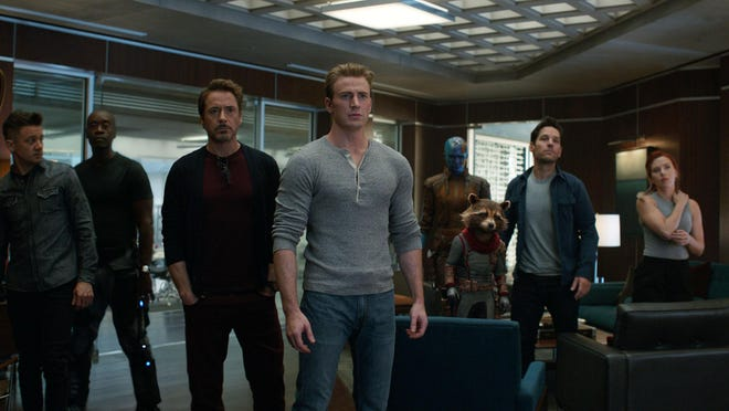 """From left, Jeremy Renner, Don Cheadle, Robert Downey Jr., Chris Evans, Karen Gillan, the character Rocket, voiced by Bradley Cooper, Paul Rudd and Scarlett Johansson in a scene from """"Avengers: Endgame."""""""