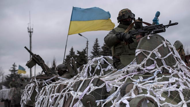 Ukrainian military vehicles drive towards Debaltseve on the outskirts of Artemivsk, eastern Ukraine, Feb. 8, 2015. T