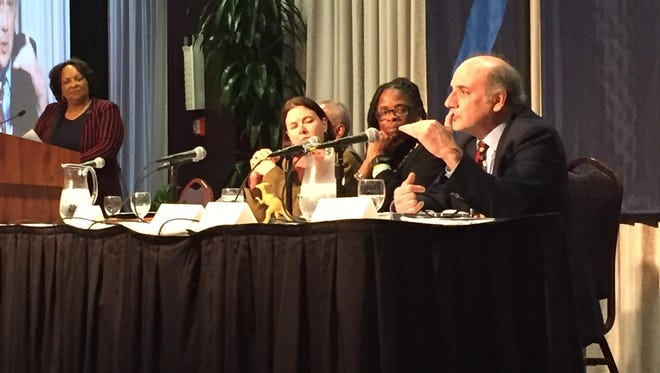 Civil rights attorney Al Gerhardstein, right, speaks Tuesday night on a panel about the civil unrest of 2001.