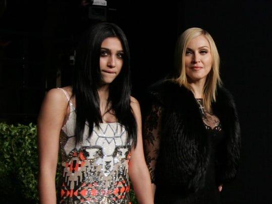 Lourdes Leon and Madonna arrive at a 2011 Oscar party.