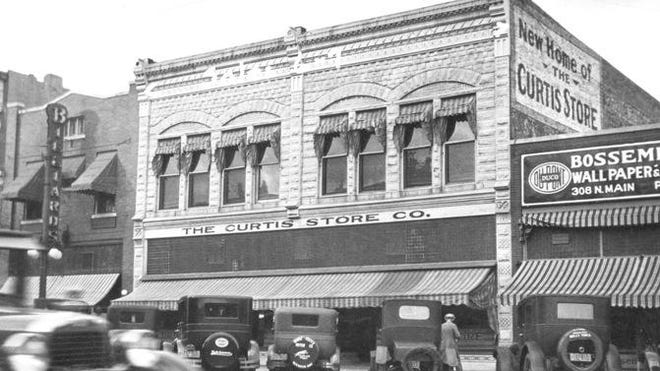 In 1924, F.R. Adams purchased  The Curtis Store and moved it to 310-312 N. Main, shown in 1929.