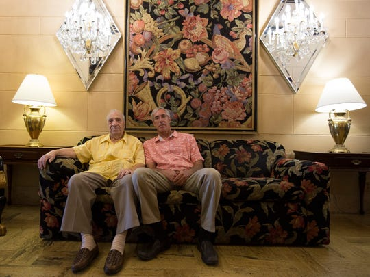 The owners of the Hotel San Carlos, Gregory and Robert Melikian sit on the couch of their lobby on May 30, 2018, in downtown Phoenix.