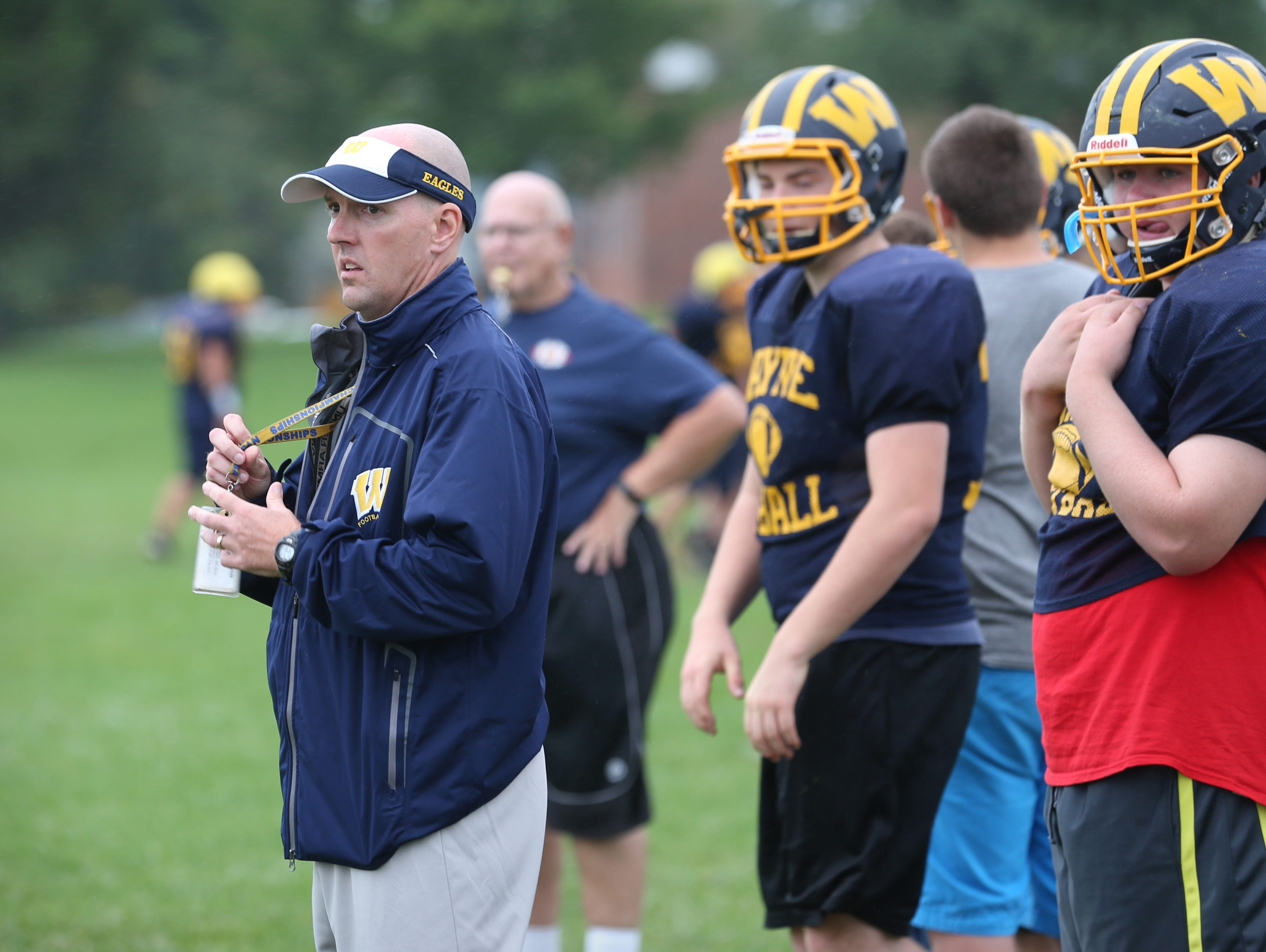 Wayne varsity football head coach David Marean watches as his offensive unit runs through plays during the team's practice at Wayne Central School in Ontario Monday, Sept. 28, 2015.