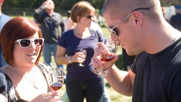 Guests sample wines at a Wine Fest.