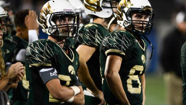 Players watch as time runs out on the Viera Hawks Friday in the state championship game.