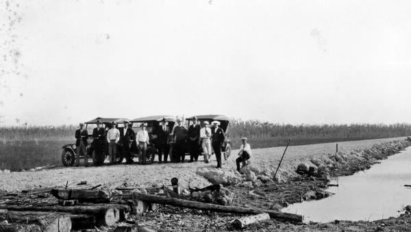"""Group gathered at the """"end of the trail"""" at the Monroe-Collier County line - Tamiami Trail, Florida"""