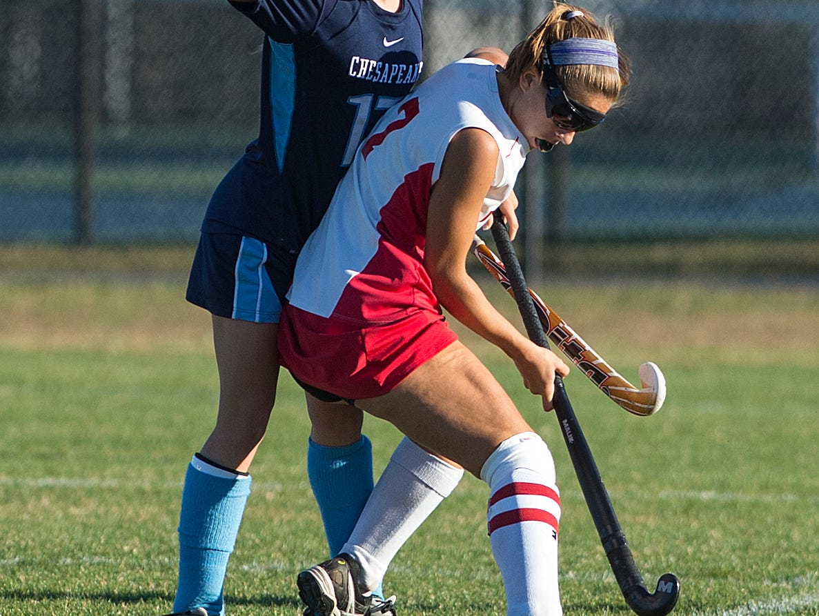 James M. Bennett's #7 Keegan Marsh competes for the ball with Chesapeake's #17 Renee Duffy. Chesapeake won 2-1 in the playoff game.