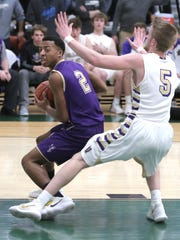 Lexington's Bryant Givand guards the ball during a sectional game against Vermilion at Madison on Tuesday.
