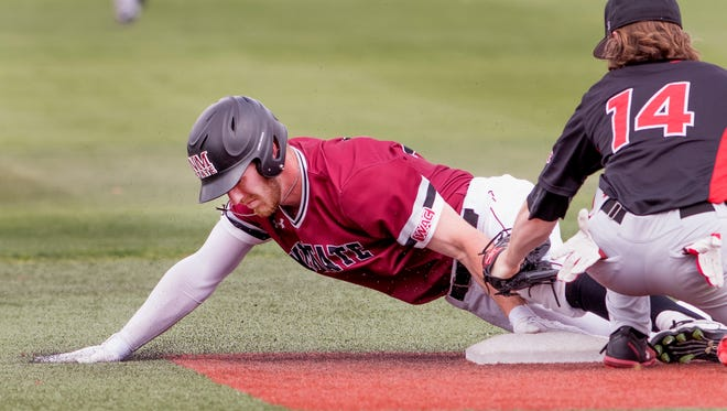 NMSU's Noah Haupt tries to keep his fingers on the bag after stealing second base against Seattle Saturday afternoon at Presley Askew Field.