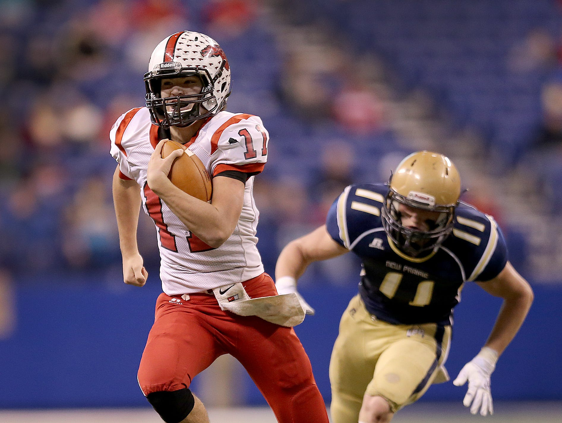 New Palestine's QB Alex Neligh put on a show in last year's 4A state title game vs. New Prairie.