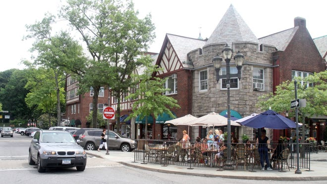People enjoy lunch outdoors at the Parkway Cafe in Scarsdale in July 2014.