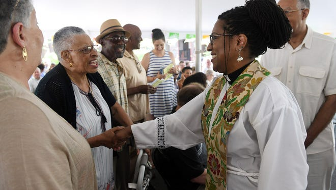 Rev. Dr. Shannon MacVean-Brown, right, and Ann Sharpe of Taylor greeet each other at Saint James Episcopal Church in Grosse Ile, Mich. on July 15, 2018. Rev. Dr. MacVean-Brown started at the church where Sharpe attends, Church of the Resurrection in Ecorse, and is now based in Indianapolis.