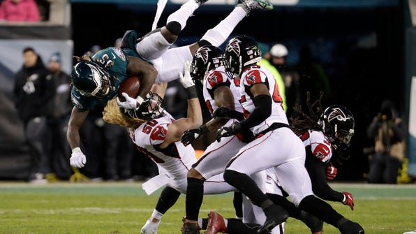 FILE - In this Saturday, Jan. 13, 2018, file photo, Philadelphia Eagles' Jay Ajayi (36) is tackled by Atlanta Falcons' Brooks Reed (50) during the first half of an NFL divisional playoff football game in Philadelphia. The Philadelphia Eagles host the Minnesota Vikings in the NFC championship on Sunday. (AP Photo/Chris Szagola, File)