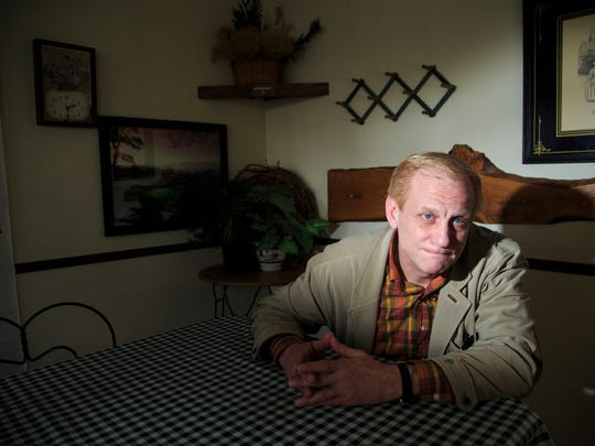 Todd Blodgett, a Republican friend of Alex Kuhn, sits at a table he and Alex would share at the Hungry Mind, a restaurant in Mason City.