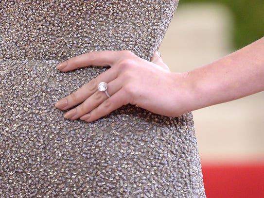 Kate Upton wears an engagement ring as she arrives