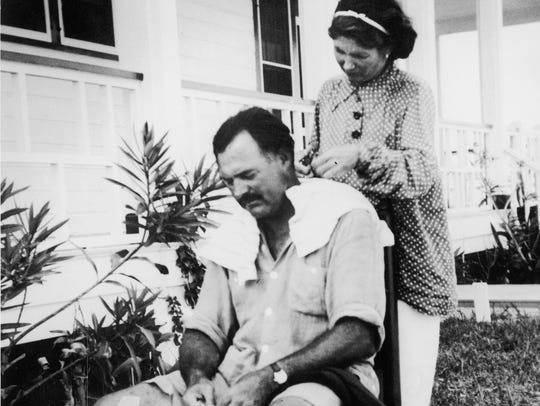 Ernest Hemingway gets a haircut from his second wife