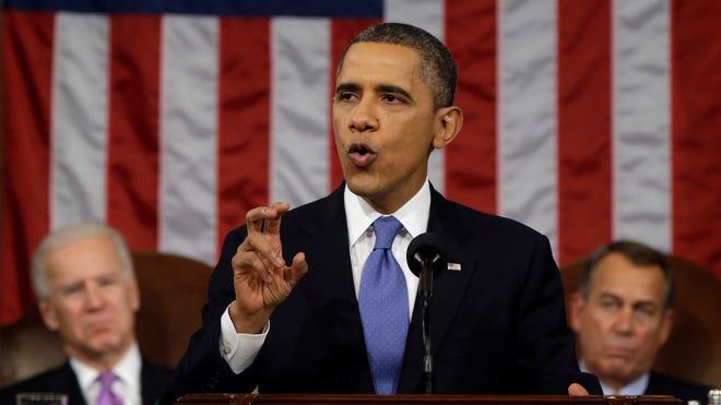 President Obama, flanked by Vice President Joe Biden and House Speaker John Boehner, gives his State of the Union address Feb. 12, 2013.