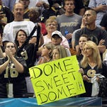 Fans cheer on the New Orleans Saints in the Superdome during a 2013 game in New Orleans.