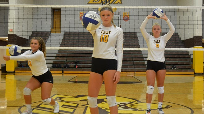 Zeeland East's Natalie Jarzembowski (left), Katie Klein and Grace Steenwyk have led the Chix to a strong start to the volleyball season.