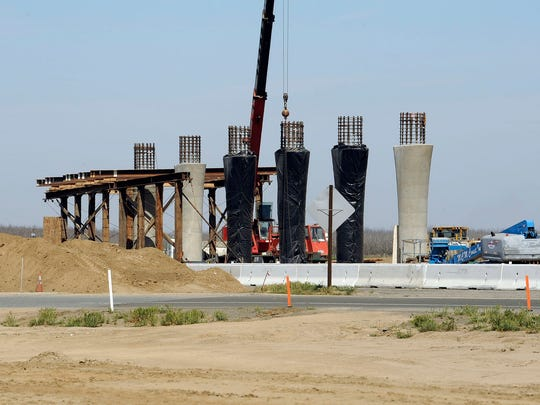 Construction continues on the Cartmill Avenue interchange at Highway 99 in Tulare. Council will consider spending $300,000 to establish a development plan for the area.