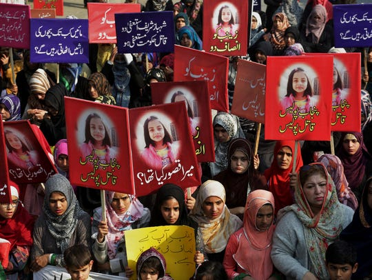 People take part in a demonstration Jan. 13, 2018, in Lahore, Pakistan, to condemn the brutal killing of Zainab Ansari, a 7-year-old girl.