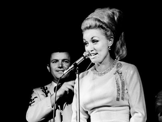 "Dolly Parton sings ""Don't Try to Cry,"" accompanied by the Wagon Masters on fiddle, during the RCA Victor breakfast and show at Municipal Auditorium on Oct. 21, 1967."