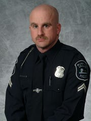 Taylor Police Officer Steven Schwein checked out a tour bus with big gold stripes stopped along I-75 in 2000.
