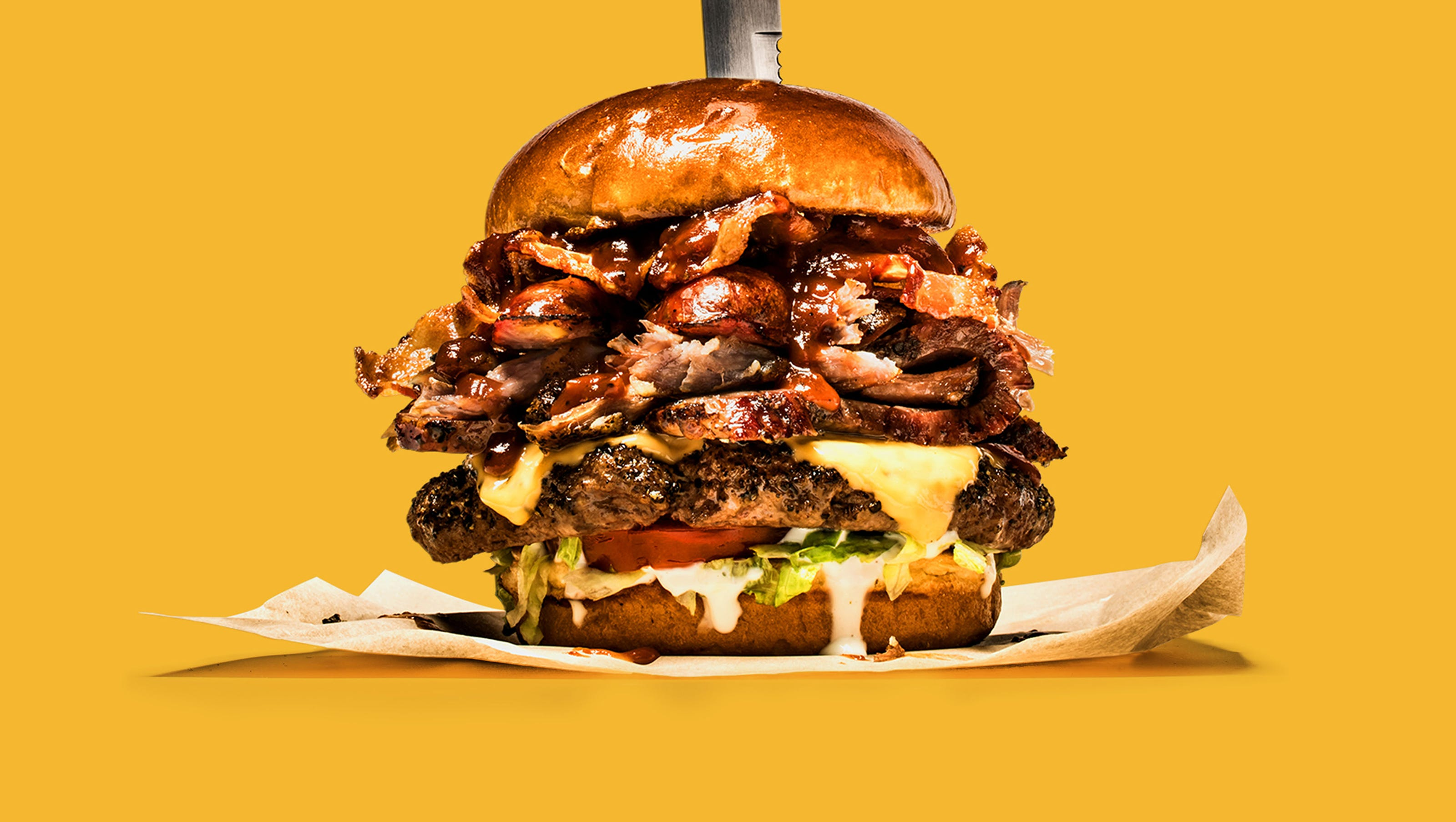 chili's 1,650 calories, half foot tall boss burger is a massive meat