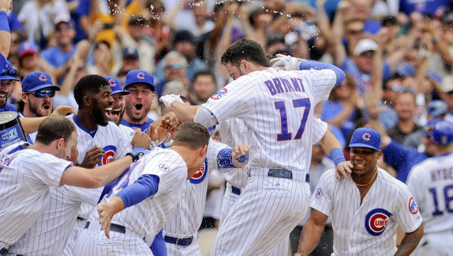 Kris Bryant (17)  is among the Chicago Cubs stars who played in Des Moines.