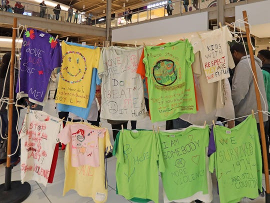 The Clothesline Project, a collection of T-shirts with