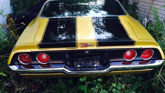 A Camaro used for promotions by Papa John's has been found in an abandoned Detroit driveway after it was stolen during the Woodward Dream Cruise.
