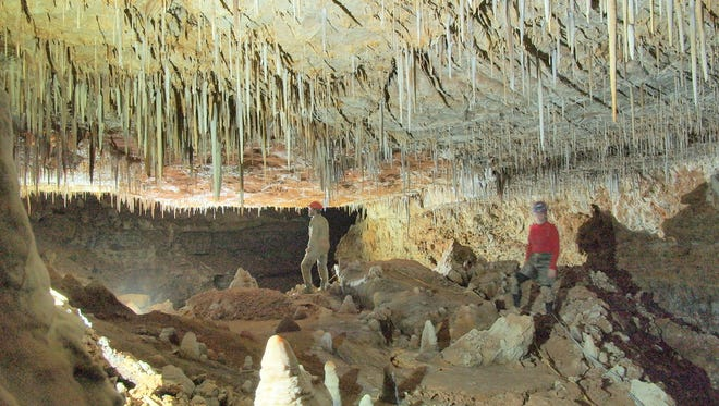 Two team members recheck a segment of The Lincoln Caverns.