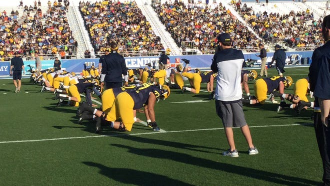The Michigan football team practices at IMG Academy in Bradenton, Fla in 2016.
