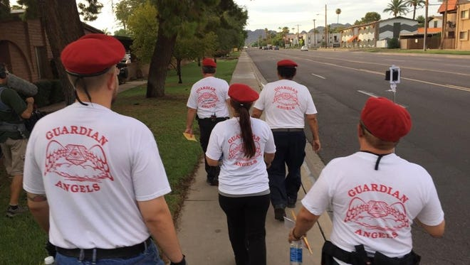 """Members of the Phoenix chapter of the Guardian Angels on Aug. 5, 2016, patrol an east Phoenix neighborhood where, on July 11, a shooting linked to the """"serial street shooter"""" occurred."""