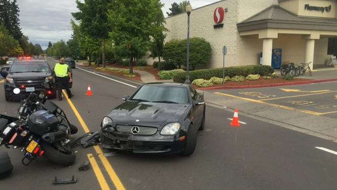 A car collided with a Keizer police motorcycle Tuesday afternoon.