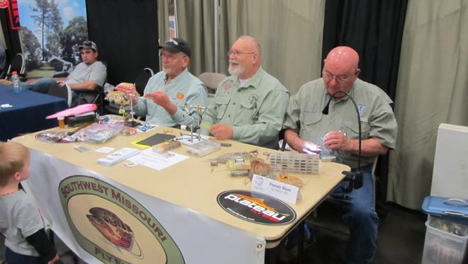 Members of the Southwest Missouri Fly Fishers tie flies at a previous Arc of the Ozarks Outdoor Show.