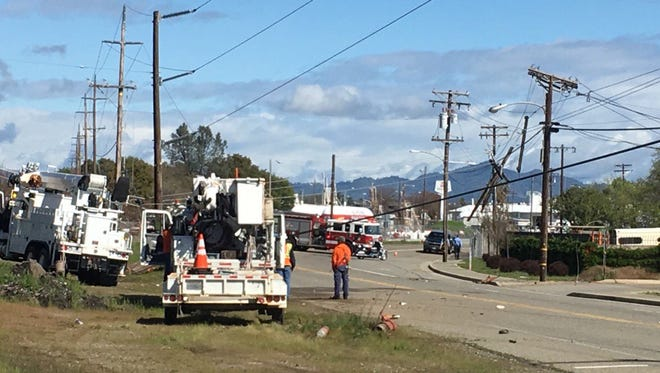 Redding Electric Utility Department on scene at a wreck that knocked down a power line on Highway 273.