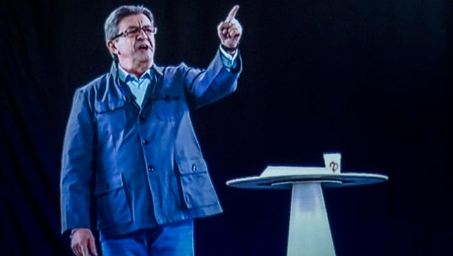 A hologram of Jean-Luc Melenchon appears to a campaign rally in Montpellier, southern France, on April 18, 2017.