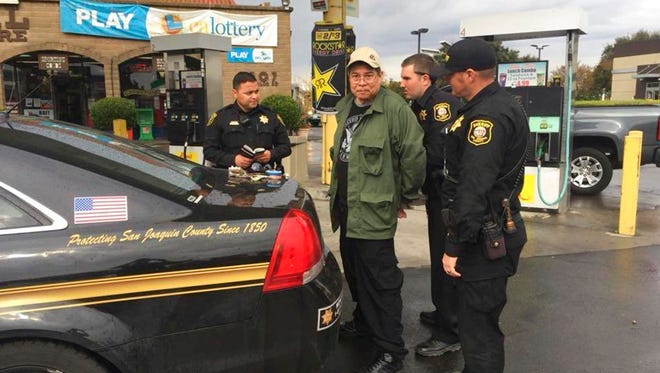 This photo provided by the San Joaquin County Sheriff's office shows Randall Saito being arrested in Stockton, Calif., Wednesday, Nov. 15, 2017.