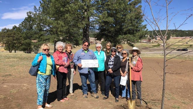 Besides donating two trees to plant in Ruidoso's dog Park, members of the Garden Club donated $200 to Keep Ruidoso Beautiful. Accepting the check was David Tetreault,  parks and recreation supervisor.