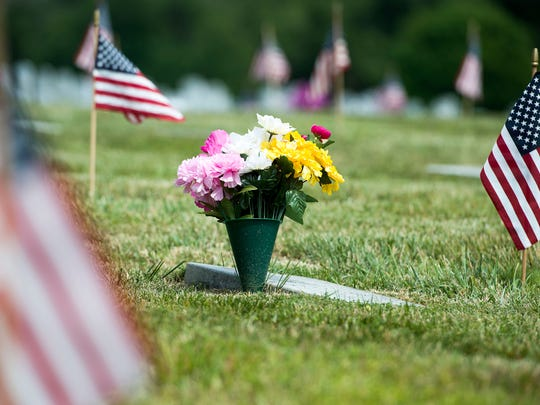 Flowers rest by the grave of a veteran May 25, 2016 at the Western Carolina State Veterans Cemetery in Black Mountain.