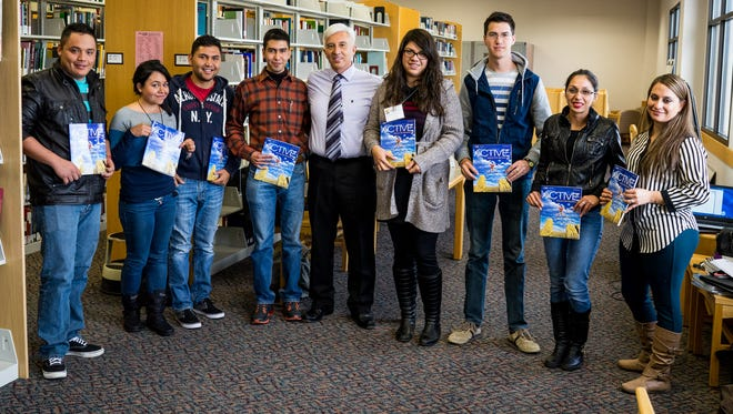 Pictured are program participants with Manuel Rodriguez, director of the Language Institute, at center.