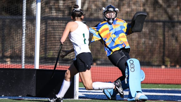 Scarsdale's Lila Horwood (91) makes a save on Shenendehowa's
