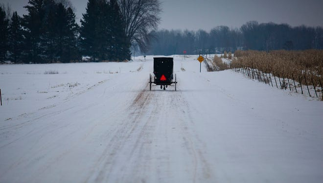 A buggy goes down a snow-covered road in Chili.