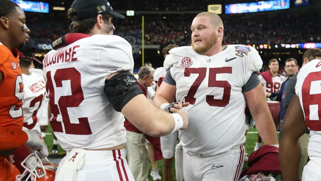 Jan 1, 2018; New Orleans, LA, USA; Alabama Crimson Tide linebacker Keith Holcombe (42) and offensive lineman Bradley Bozeman (75) celebrate after the game against the Clemson Tigers in the 2018 Sugar Bowl college football playoff semifinal game at Mercedes-Benz Superdome. Mandatory Credit: Chuck Cook-USA TODAY Sports