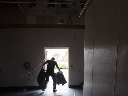 Noe Pena, an employee of Manufacturers Products, cleans